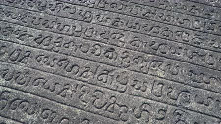 gal : Ancient writings inscribed in granite on the Gal Pota. or Stone Book. an important and enormous archaeological artifact in Polonnaruwa.
