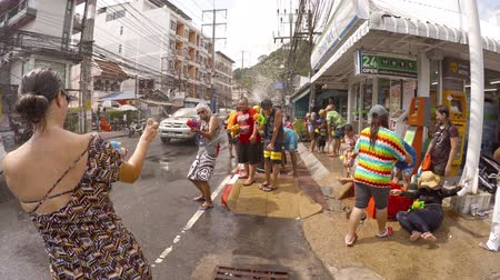 unutulmayan : PATONG. PHUKET. THAILAND 13 APR 2016: Funny tourists pour water on Songkran festival