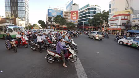 two wheeled : SAIGON. VIETNAM - CIRCA JAN 2016: Heavy motorcycle traffic on a typical urban street in Saigon. 4k footage