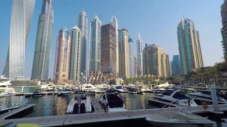 camionagem : DUBAI. UAE - CIRCA OCT 2016: Luxury yachts and new high-rise residential buildings on background. FullHD 1080 footage Stock Footage