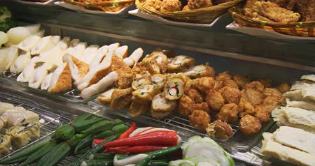 dimsum : Assortment of tasty foods. including vegetables. seafood and more. at a popular Chinese buffet restaurant. 4k DCI video