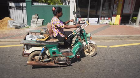 improvised : COLOMBO. SRI LANKA - CIRCA NOV 2016: Improvised Motor Tricycle. Modified for Use by Disabled Woman on Public Road. FullHD 1080p footage