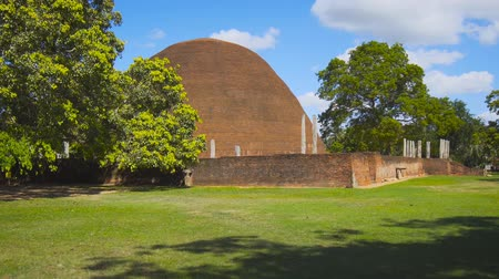 domed structure : Sandagiri Stupa. an ancient. domed. Buddhist structure made of red bricks. an important religious site in Tissamaharama. Sri Lanka. FullHD 1080p video