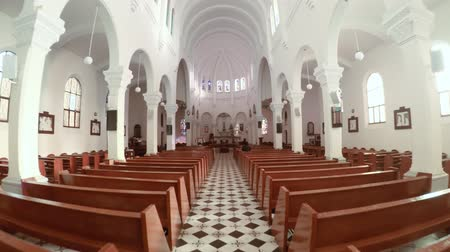 ga : DALAT. VIETNAM - JAN 2016: Interior of the Da Lat Cathedral. with Ornate Columns and Hardwood Pews. in Vietnam. 4k video Stock Footage
