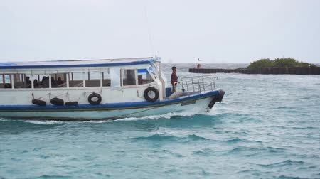 water taxi : HULHUMALE. MALDIVES - DEC 2016: Water Taxi Cruises through Harbor at Hulhumale Island in Slow Motion. Video 1080p
