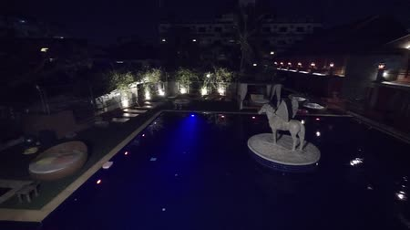 pegaz : CHIANG RAI. THAILAND JAN 2018: Overlooking view of the pool at the Chaya Resort and Spa. at night. FullHD 1080p video