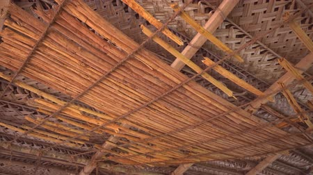 hikkaduwa : Long strips of cinnamon bark. suspended on a horizontal network of natural ropes at this traditional workshop in Hikkaduwa. Sri Lanka. Ultra HD 4k video