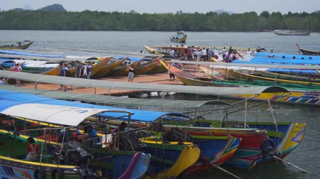 arriving : PHANG-NGA. THAILAND - APR 2018: Colorfully Painted Longtail Tour Boats Docked at Panyee Island in Southern Thailand. UltraHD 4k video