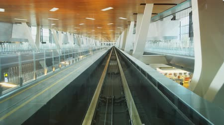 concourse : STATE OF QATAR - MAY 2018: Passenger Perspective of Ride on Light Rail Train between Terminals at Hamad International Airport. 4k footage Stock Footage