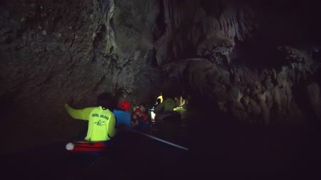 canoes : PHANG-NGA. THAILAND - APR 2018: Tourists Paddling through a Sea Cave on Rented Kayaks in Southern Thailand. 1080p stock footage Stock Footage