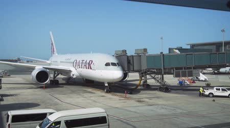 docking : STATE OF QATAR - MAY 2018: Qatar Airways passenger liner at a docking sleeve at Hamad International Airport