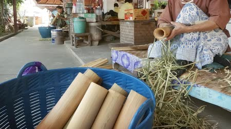 bamboo basket : CHIANG MAI. THAILAND JAN 2018: Shaving Green Bamboo for Use in Paper Umbrella Production at Local Workshop. 1080p stock footage