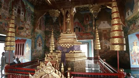 murals : CHIANG MAI. THAILAND JAN 2018: Tourists Visit and Photograph the Intricately Decorated Interior of Wat Chedi Luang. 4k Ultra HD video Stock Footage