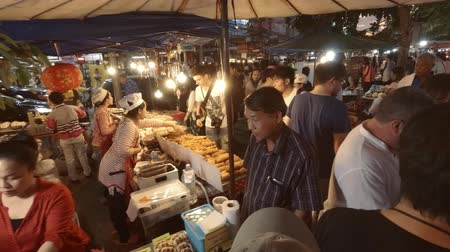 public worker : CHIANG MAI. THAILAND JAN 2018: Local Vendors Selling Seafood and Thai Street Foods at Public Market. Ultra HD 4k video