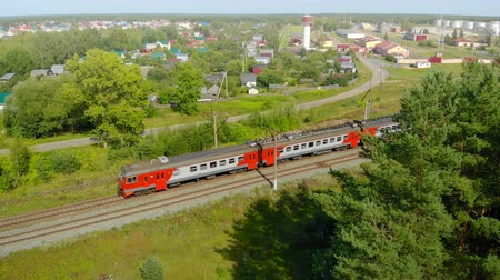LUKINO. RUSSIA - AUG 2018: Passenger Train Rolling through Suburban Lukino Stock Footage