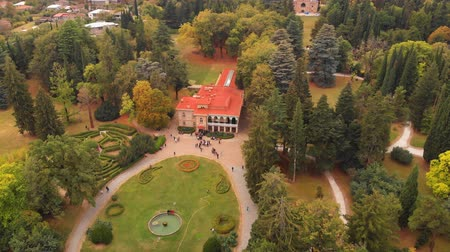 TSINANDALI. GEORGIA - OCT 2018: Aerial view of tourists gathered outside the historic mansion of poet Alexander Chavchavadze on the famous Tsinandali vinyard in the Georgian Republic