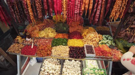 KUTAISI. GEORGIA - OCT 2018: Vendor stall at Kutaisi Public Market. selling traditional churchkhela candies and dried fruits.