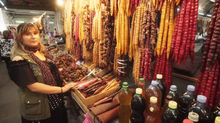 market vendor : KUTAISI. GEORGIA - OCT 2018: Local vendor selling traditional Churchkhela Candies at Kutaisi Public Market