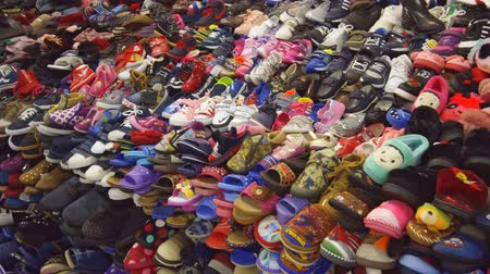 KUTAISI. GEORGIA - OCT 2018: Vendor stall selling kids shoes at the public market in Kutaisi.