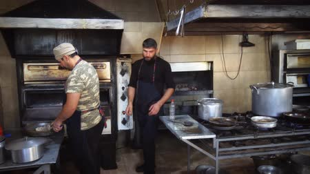 KUTAISI. GEORGIA - OCT 2018: Workers cooking Inside the kitchen of a popular. local restaurant.