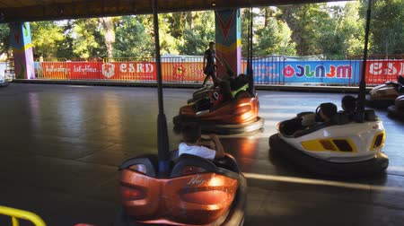 KUTAISI. GEORGIA - OCT 2018: Children ride bumper cars at a popular. local amusement park.