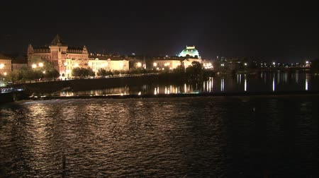 wavelet : Riverbank in Prague with reflections in the river and wavelet from weir. Time lapse. Stock Footage