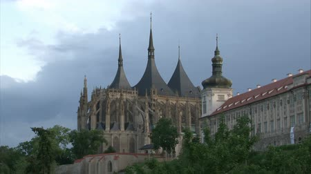 kutna : Gothic cathedral St. Barbora in Kutna Hora with flowing clouds at dusk. Time lapse. Stock Footage