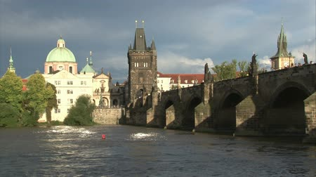 prague bridge : Prague embankment and Charles bridge with flood on Vltava river. Stock Footage