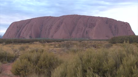 authorities : PR available - image approved for commercial use by Park authorities. Uluru - Ayers Rock. Aboriginal sacred place. UNESO world heritage. Sunrise sun is color painting red sandstone rock. Time lapse.