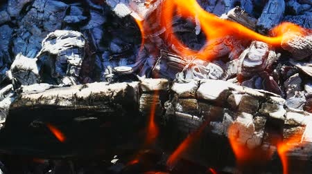 преломление : Burning firewood with red coil and with tongue of flames, horizontal macro panorama