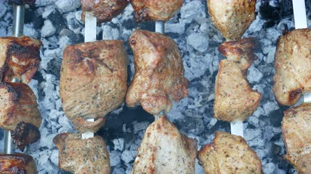 baking dishes : Preparing of meat shashlik or shish kebab on the rotating metal skewers, macro background Stock Footage