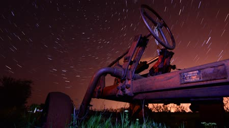 toscana : Circles of time concept - timelapse with old rusty tractor on star trails night background
