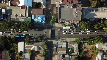 krasnodar city : Abstract aerial drone footage of rooftops and streets in the center of Krasnodar city, Russia. Traffic congestion rush hour.