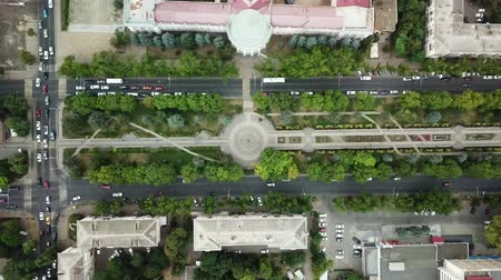 krasnodar city : Summer 2018 aerial drone footage of rooftops and streets in the center of Krasnodar city, Russia. Top down view of traffic jam. Stock Footage