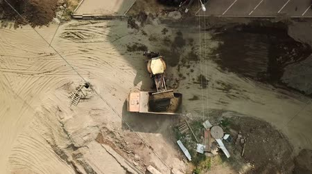 krasnodar city : Aerial flight over earth moving machines and construction site. Construction crews prepare a site for a building . Digger, truck and bulldozer preparing ground for construction. Stock Footage