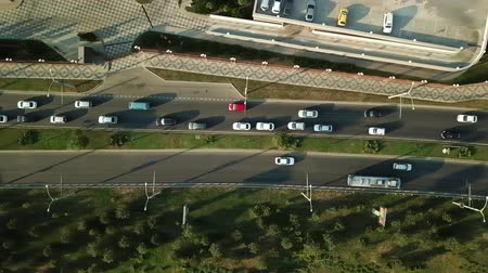 krasnodar city : Aerial Drone Flight View of freeway busy city rush hour heavy traffic jam highway, .  Aerial view of the vehicular intersection,  traffic at peak hour with cars on the road and on the bridge.