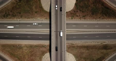reçel : Summer aerial footage of transport junction, traffic cross road junction day view from above with circle road. Top down view of traffic jam.
