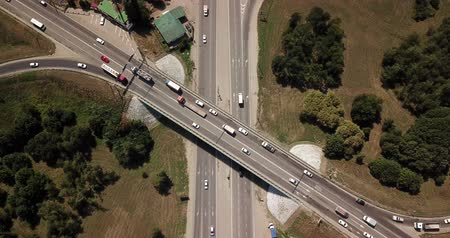 Top down aerial view of transportation highway overpass, ringway, roundabout