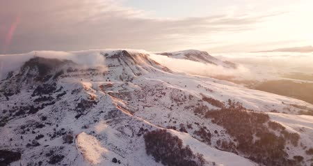 Great aerial landscape mountain view of the snowy massive rock in sunlight. Stock Footage