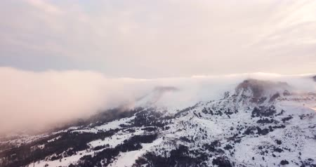 Epic Aerial Flight Near Mountain Clouds Towards Sunrise. Picturesque and gorgeous scene. Stock Footage