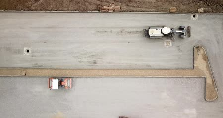Aerial top down view of construction road and parking, construction machinery in operation