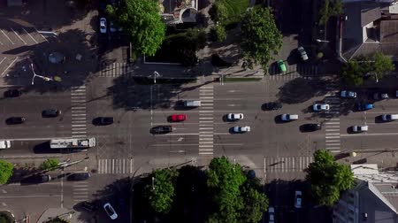 csomópont : Drones Eye View - Aerial view of the vehicular intersection, fly under trees. Stock mozgókép