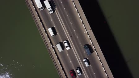 otoyol : Drones Eye View - 4K road under a bridge urban traffic jam Stok Video