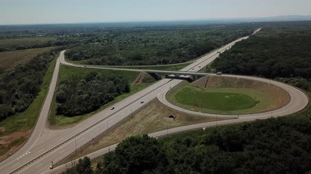 autobahn : Aerial view of cloverleaf highway road junction in the countryside with trees