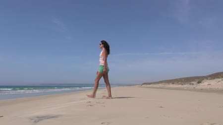 Андалусия : adult woman walking in a beach next to Zahara village at Cadiz Spain