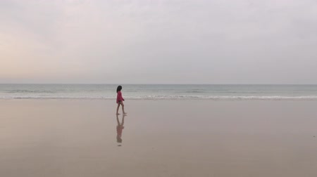 jarse : adult woman in walking in a beach next to Zahara village at Cadiz Spain