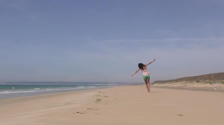 napos : adult woman playing to fly in a beach next to Zahara village at Cadiz Spain