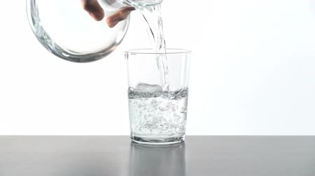 doldurmak : man hand serving water in crystal glass on table