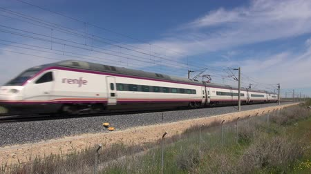 modern train wagon : railway with high speed train at a landscape in Spain