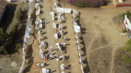 szárítókötél : Aerial view with white cloth, clothes hanging on a clothesline in the yard , shot on tilt shift lens